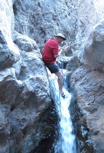 Kelly Hand-Walking Down Warm Waterfall