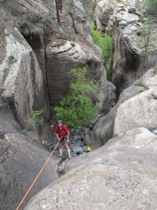 Kelly Descending the First Rappel